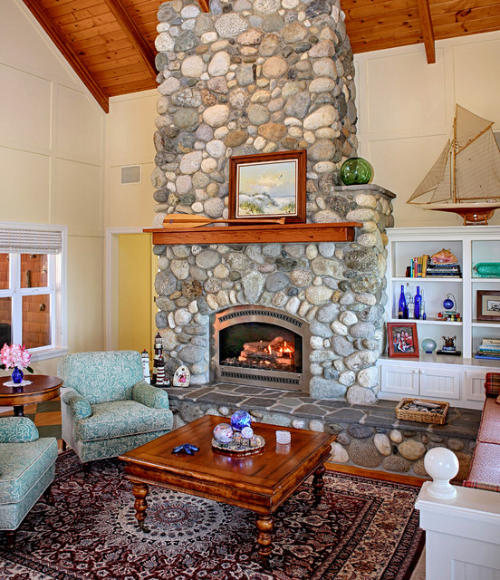 living room with stone fireplace beach style living