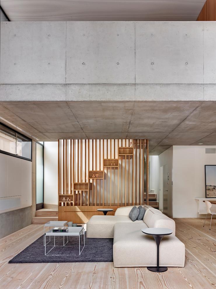Example of a trendy open concept light wood floor living room design in Sydney