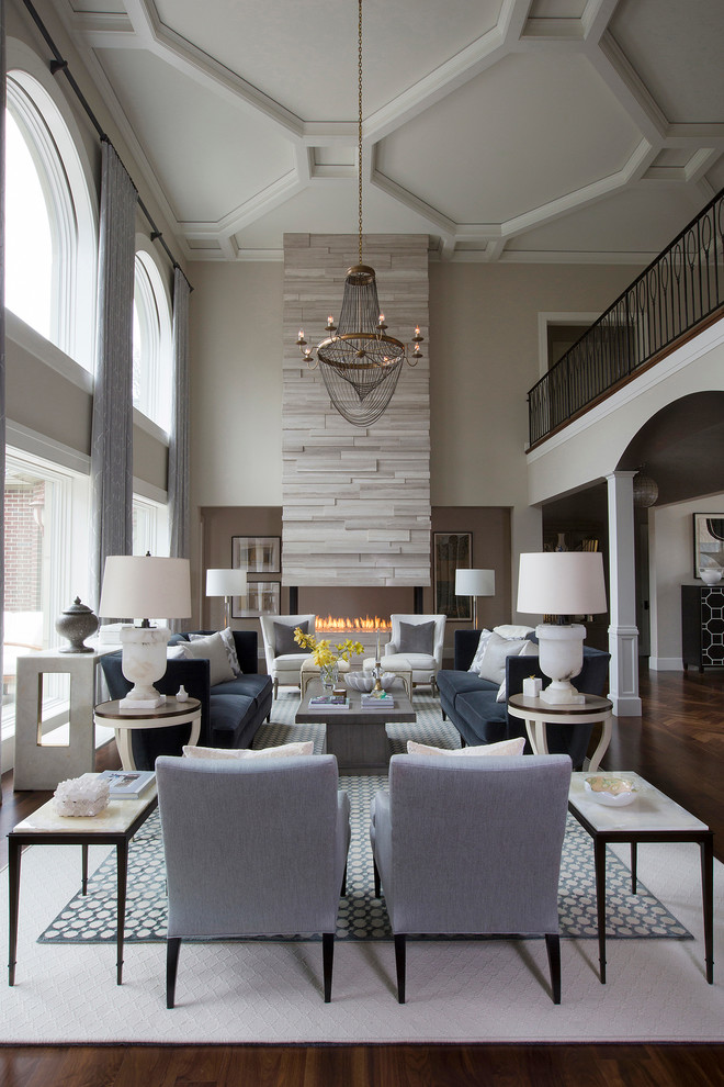 Inspiration for a large transitional formal and open concept medium tone wood floor living room remodel in Other with gray walls, a two-sided fireplace, a stone fireplace and no tv