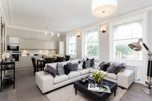 white couch living room. Trendy open concept medium tone wood floor living room photo in London with  beige walls White Couch Houzz