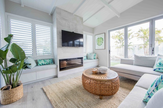 Inspiration for a mid-sized beach style open concept living room in Gold Coast - Tweed with white walls, painted wood floors, a standard fireplace, a stone fireplace surround and grey floor.