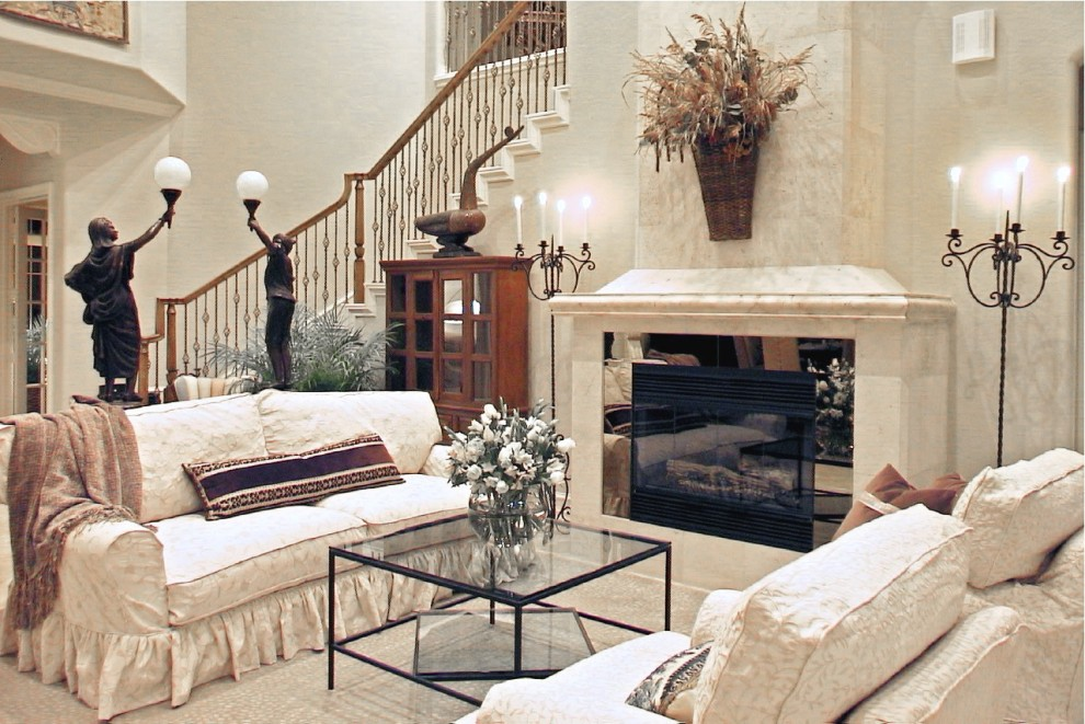 Eclectic living room photo in Houston with a standard fireplace and no tv