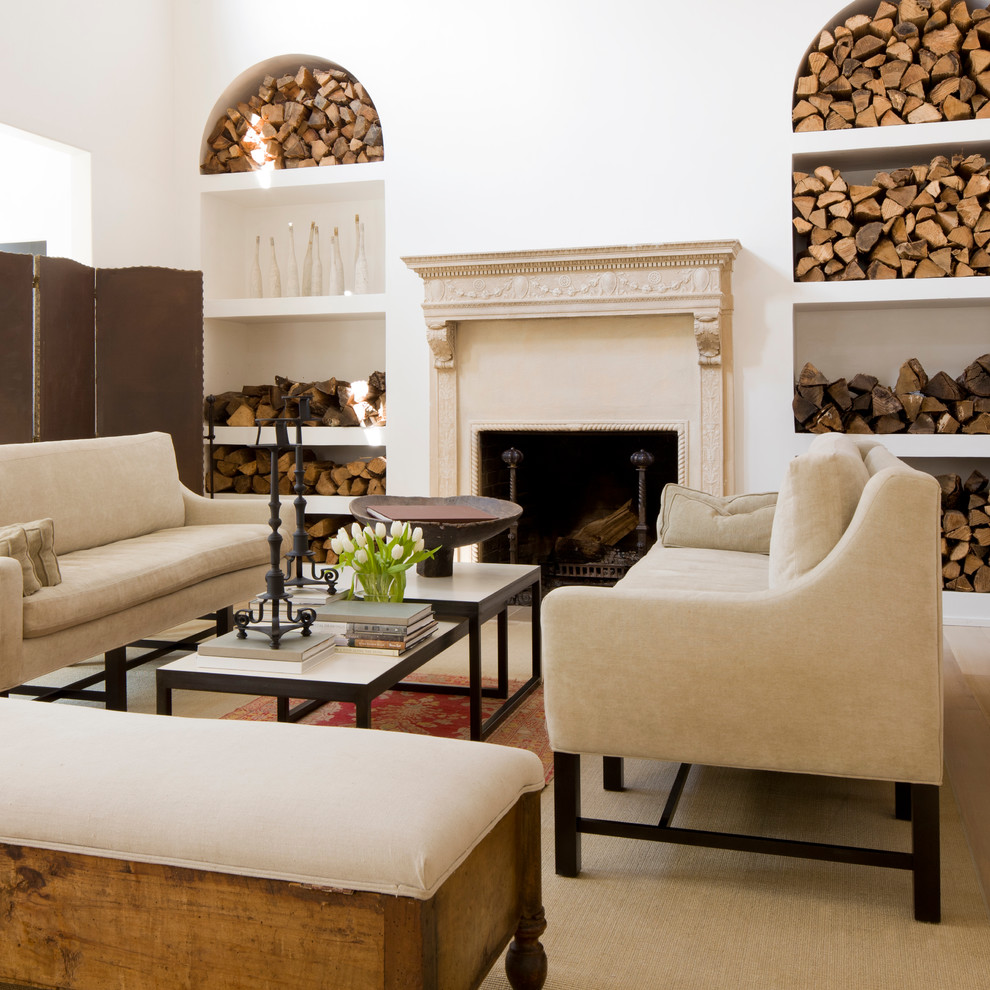 Example of a classic living room design in Other with white walls and a standard fireplace