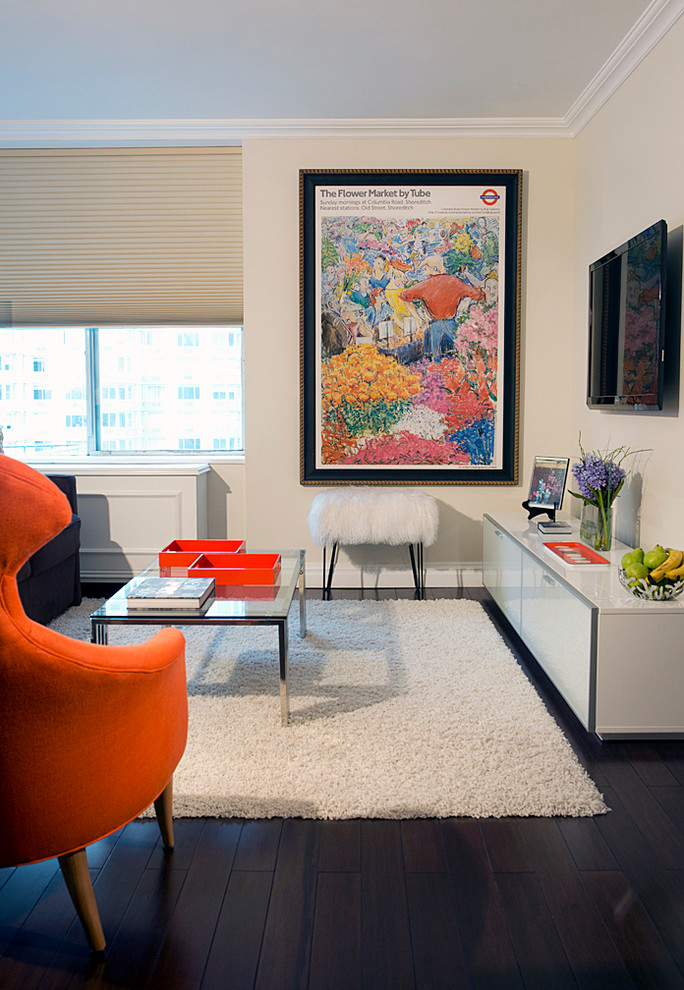 Inspiration for a small contemporary open concept living room remodel in New York with beige walls and a wall-mounted tv