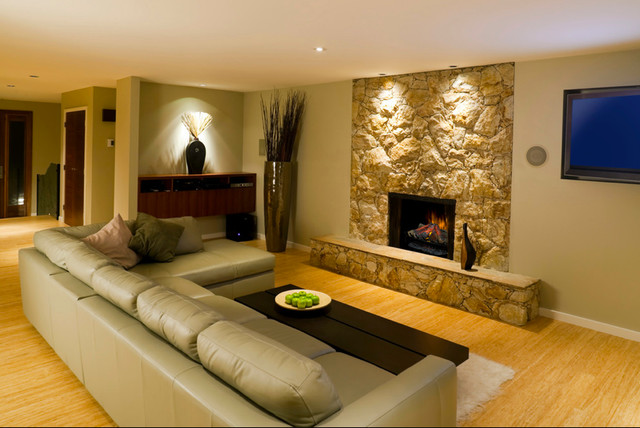 A stone mantel retrofit with an electric fireplace is a safe and energy efficient way to add ambiance to your living room.