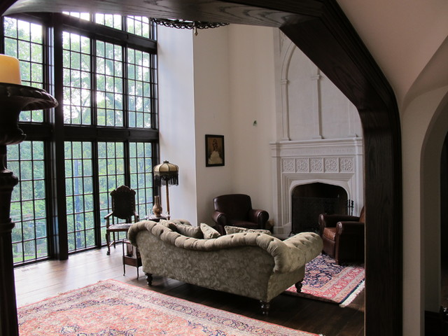 inspiration for a timeless living room remodel in toronto with white walls a standard fireplace - Gothic Living Room