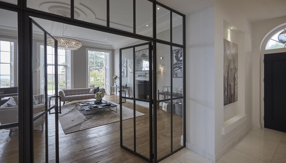 Example of a trendy enclosed medium tone wood floor living room design in Hertfordshire
