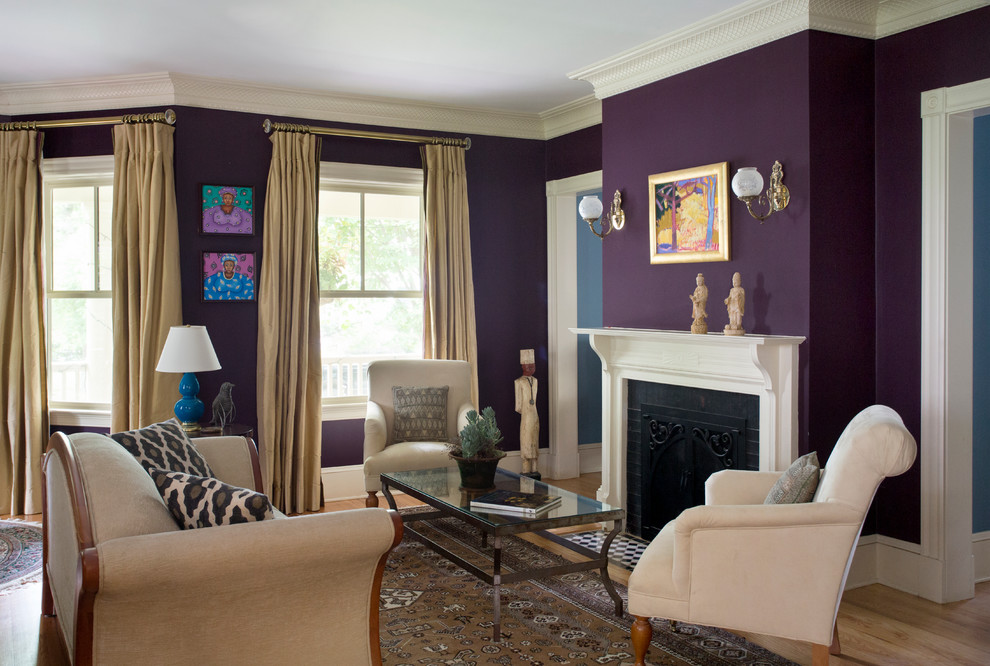 Living room - mid-sized traditional formal and open concept medium tone wood floor living room idea in Boston with purple walls, no tv and a standard fireplace