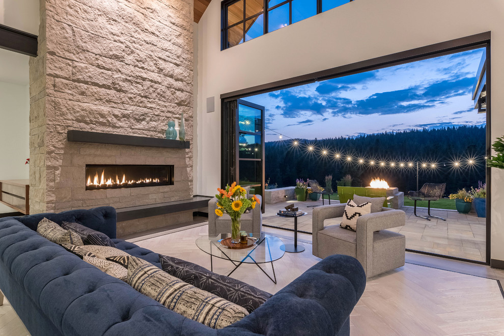 Trendy beige floor living room photo in San Francisco with white walls, a ribbon fireplace and a stone fireplace