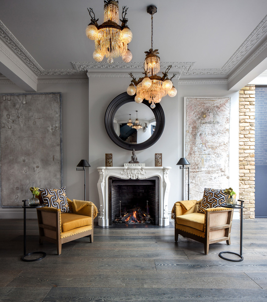 Inspiration for a transitional dark wood floor living room remodel in London with gray walls, a standard fireplace and no tv