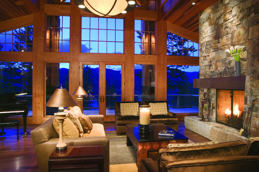 Inspiration for a rustic living room remodel in Minneapolis with a stone fireplace