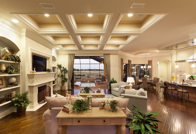 Example of a huge classic open concept living room design in Tampa with a  standard fireplace