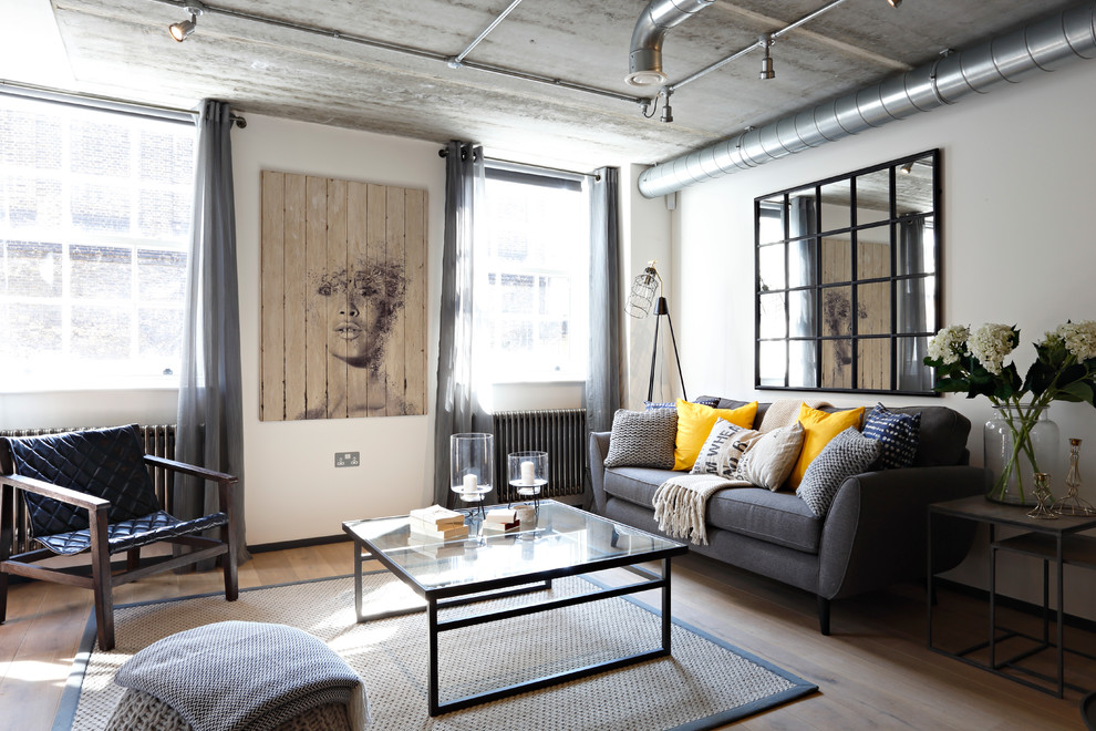 Urban light wood floor living room photo in London with white walls, no fireplace and no tv