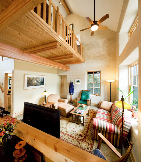 Green cottage family room with loft above rustic for Build your living room