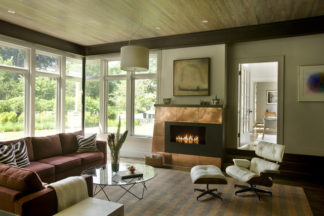 Inspiration for a contemporary living room remodel in Boston with beige walls and a ribbon fireplace