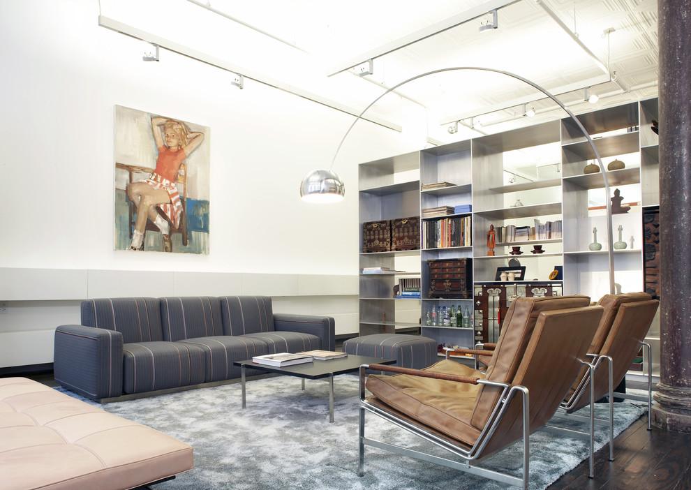 Minimalist dark wood floor living room photo in New York with white walls