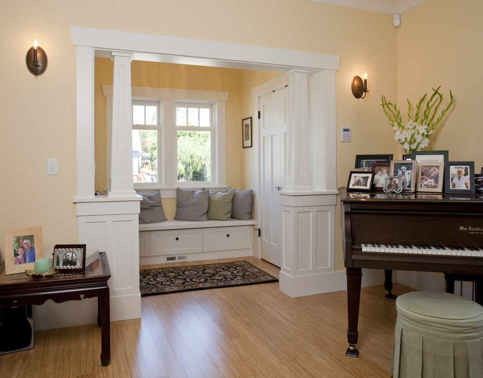 Inspiration for a craftsman living room remodel in Seattle with a music area and orange walls