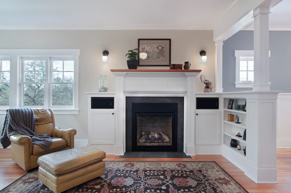 Example of a mid-sized classic open concept medium tone wood floor and brown floor living room design in Seattle with beige walls, a standard fireplace and a tile fireplace
