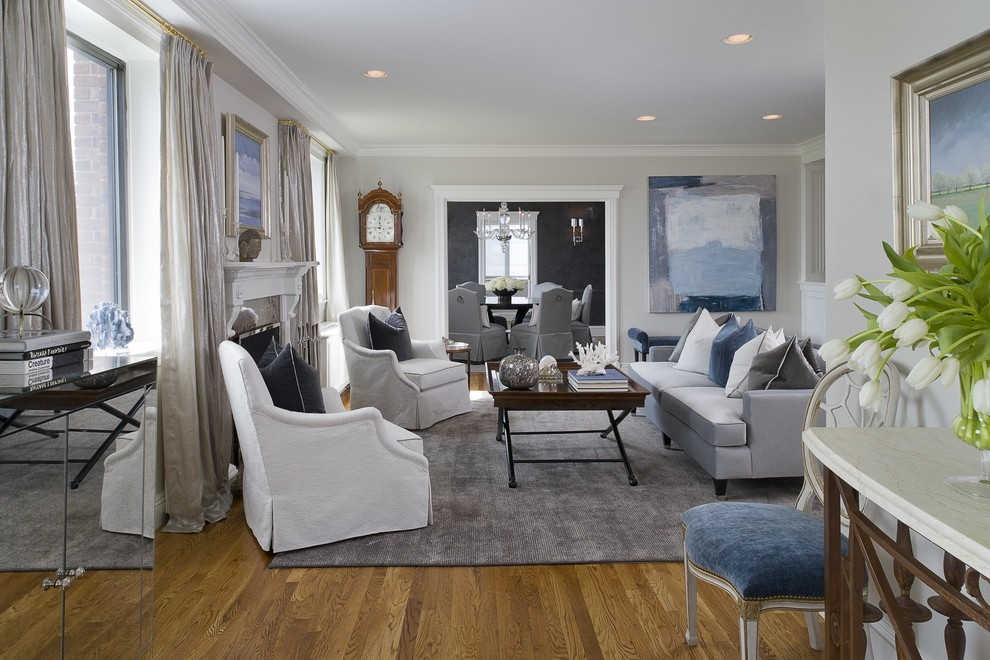 Living room - mid-sized transitional formal and enclosed medium tone wood floor living room idea in New York with gray walls, a standard fireplace, no tv and a stone fireplace