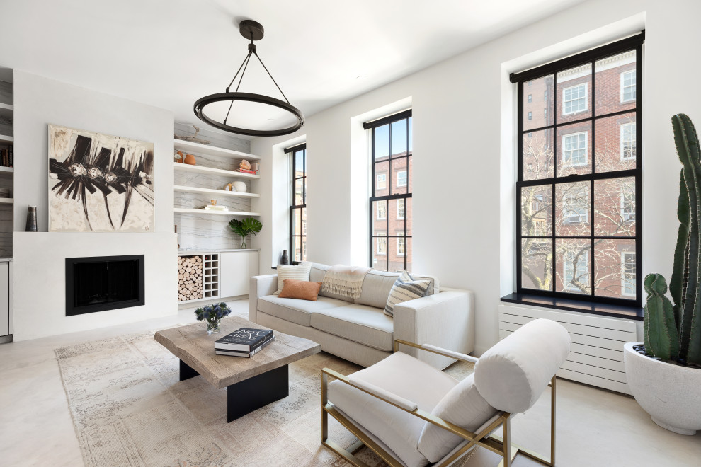 Inspiration for a small contemporary open concept concrete floor and beige floor living room remodel in New York with white walls, a standard fireplace and a plaster fireplace