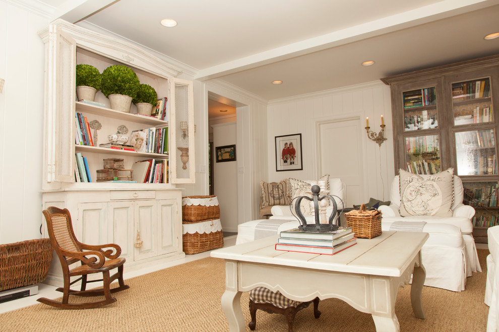 Living room - shabby-chic style enclosed living room idea in Portland with white walls