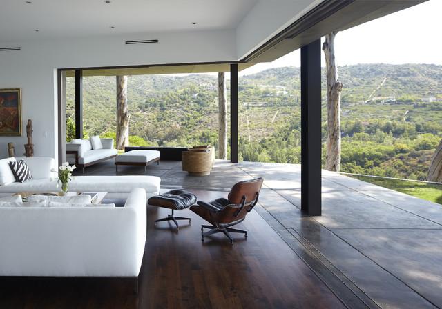 Mid-sized minimalist open concept dark wood floor living room photo in Los Angeles with & Telescoping Doors | Houzz pezcame.com