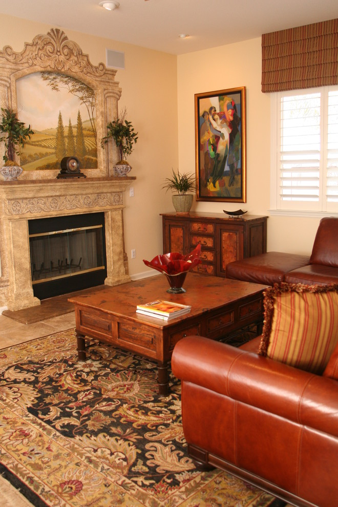 Example of a tuscan living room design in San Francisco with beige walls and a standard fireplace