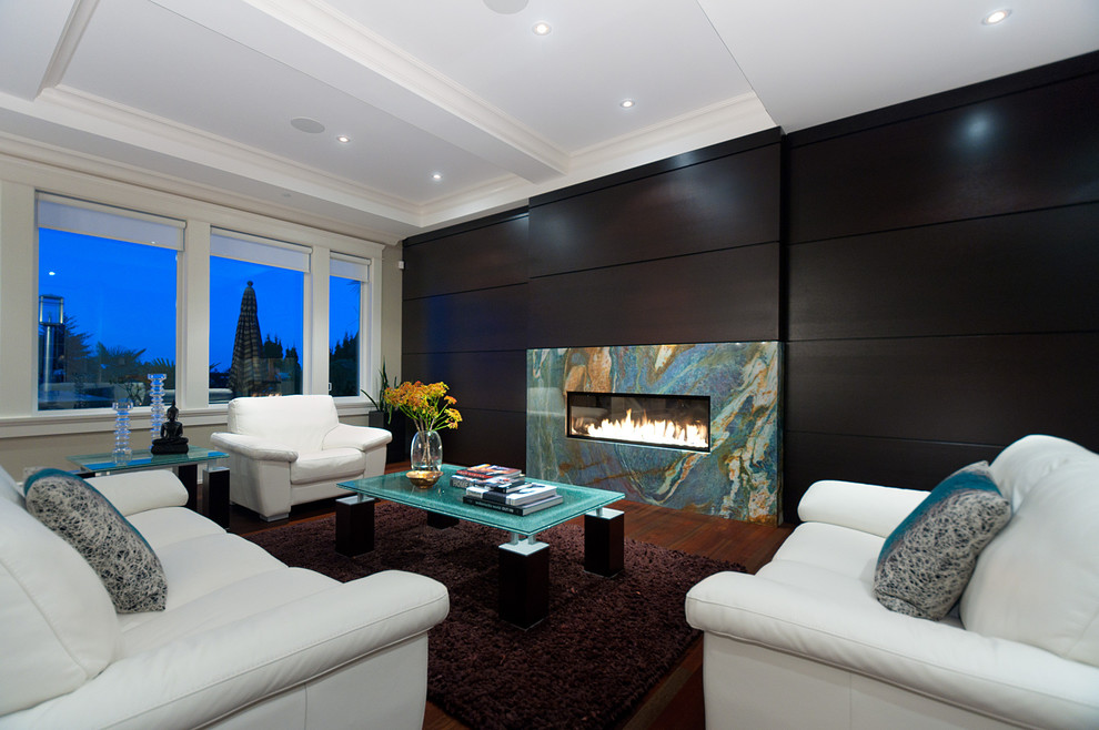 Inspiration for a large contemporary open concept dark wood floor living room remodel in Vancouver with a ribbon fireplace, a stone fireplace and no tv