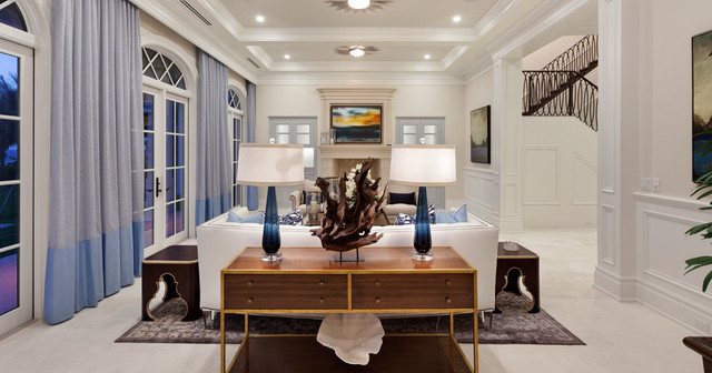 Inspiration for a large transitional formal and enclosed marble floor living room remodel in Miami with white walls, a standard fireplace, a stone fireplace and no tv