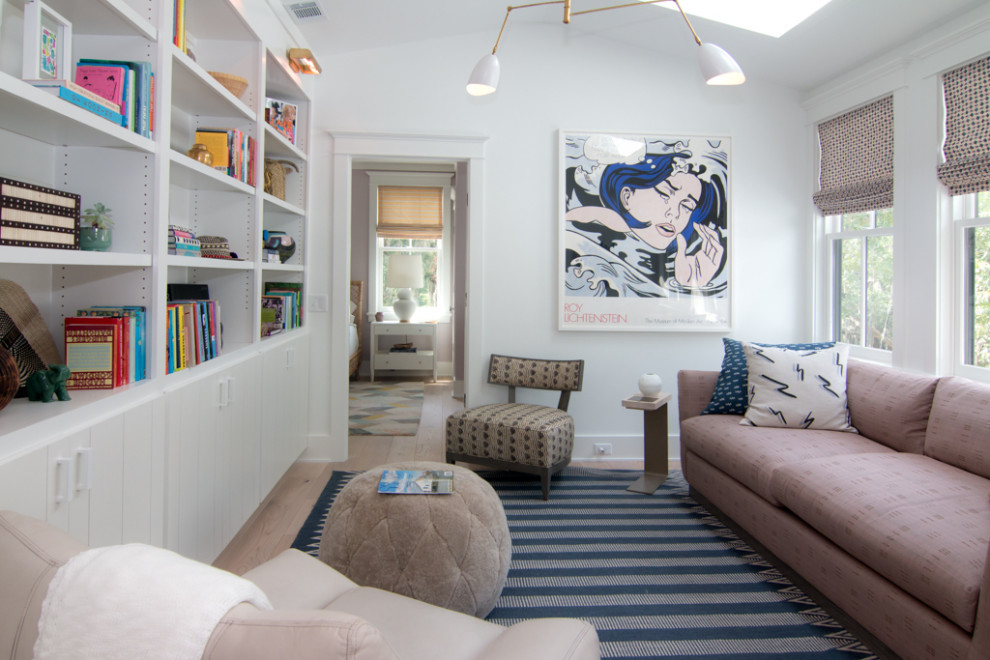 Living room library - transitional light wood floor and beige floor living room library idea in Atlanta with white walls