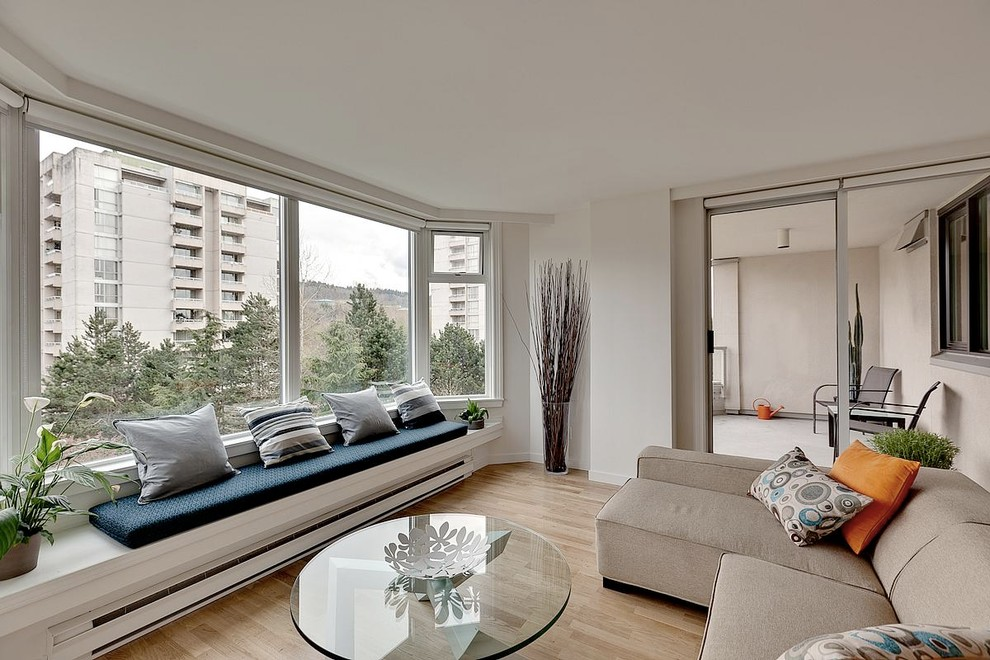 Inspiration for a modern living room remodel in Vancouver with white walls