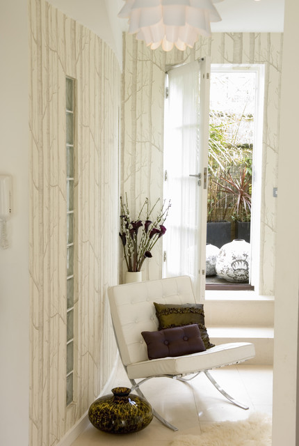 Inspiration for an eclectic living room in London with white walls.