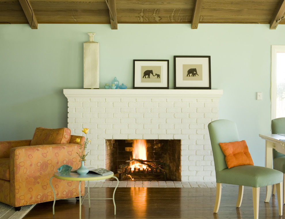 Inspiration for a rustic living room remodel in San Francisco with blue walls and a standard fireplace