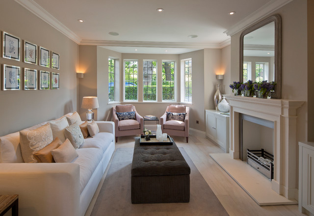 Transitional Enclosed Living Room Idea In London With Beige Walls And A  Standard Fireplace