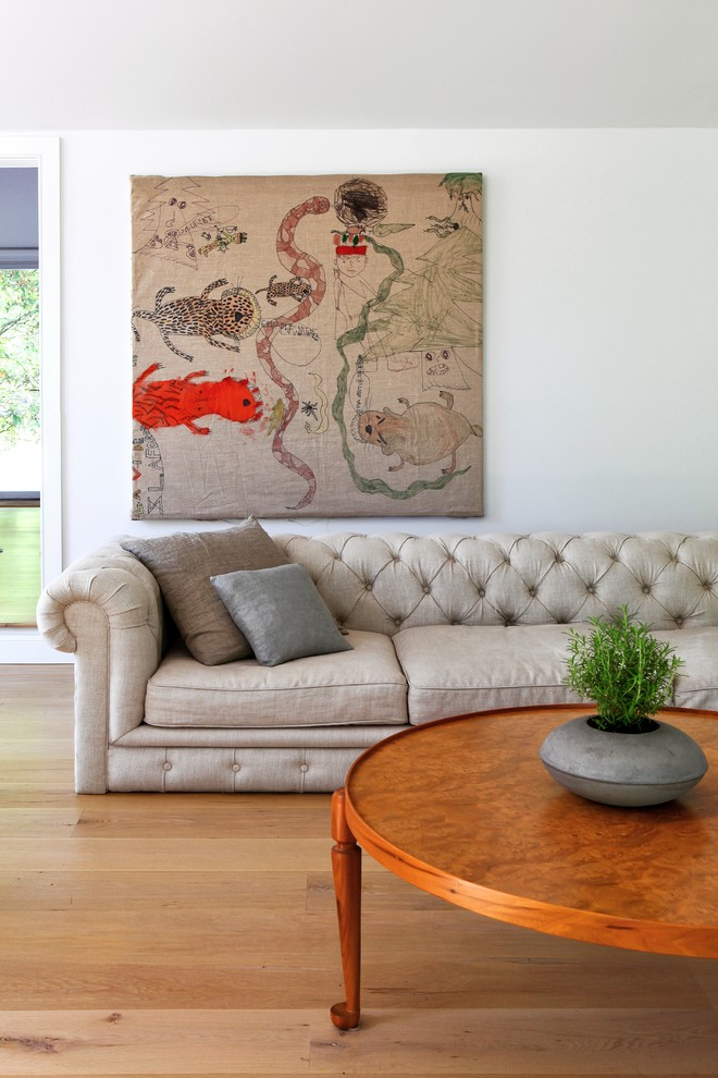 Inspiration for a contemporary living room remodel in New York with white walls