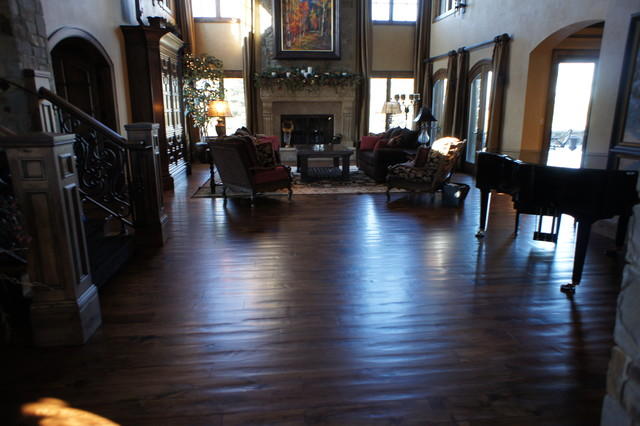 Hand scraped wide plank dark wood floor traditional for Living room ideas with dark hardwood floors