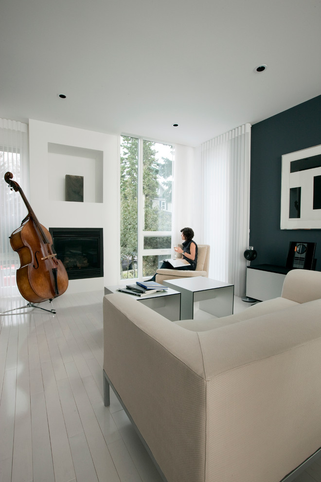 Inspiration for a contemporary painted wood floor and white floor living room remodel in Calgary