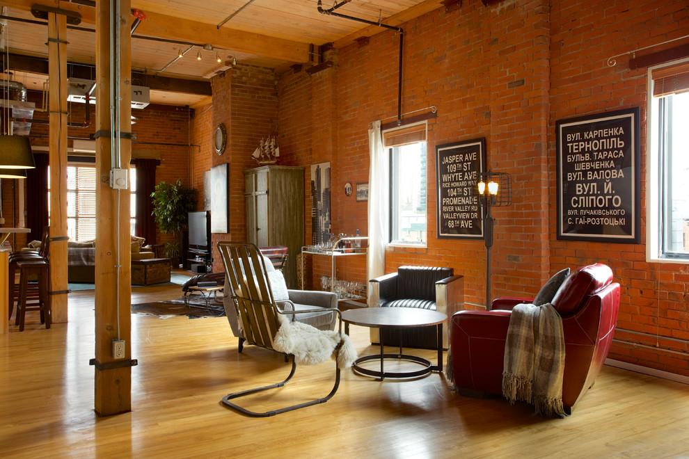 Example of a huge urban open concept medium tone wood floor living room design in Edmonton with orange walls