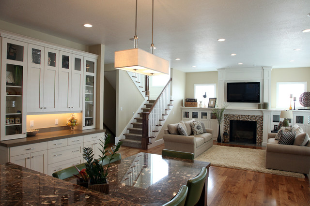 Example of a mid-sized classic open concept medium tone wood floor living room design in Salt Lake City with beige walls, a standard fireplace, a tile fireplace and a wall-mounted tv
