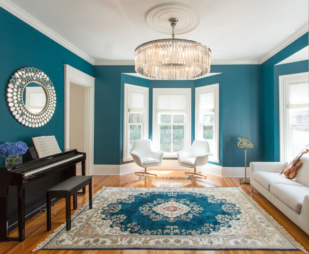 Living room - mid-sized transitional enclosed medium tone wood floor living room idea in Boston with a music area, blue walls and no tv