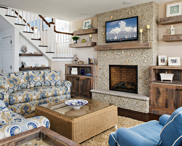 Coastal living room photo in New York with beige walls, a standard fireplace and a wall-mounted tv