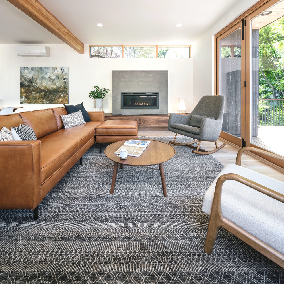 Danish medium tone wood floor and brown floor living room photo in Portland with white walls and a ribbon fireplace
