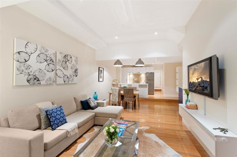 Example of a small minimalist living room design in Sydney