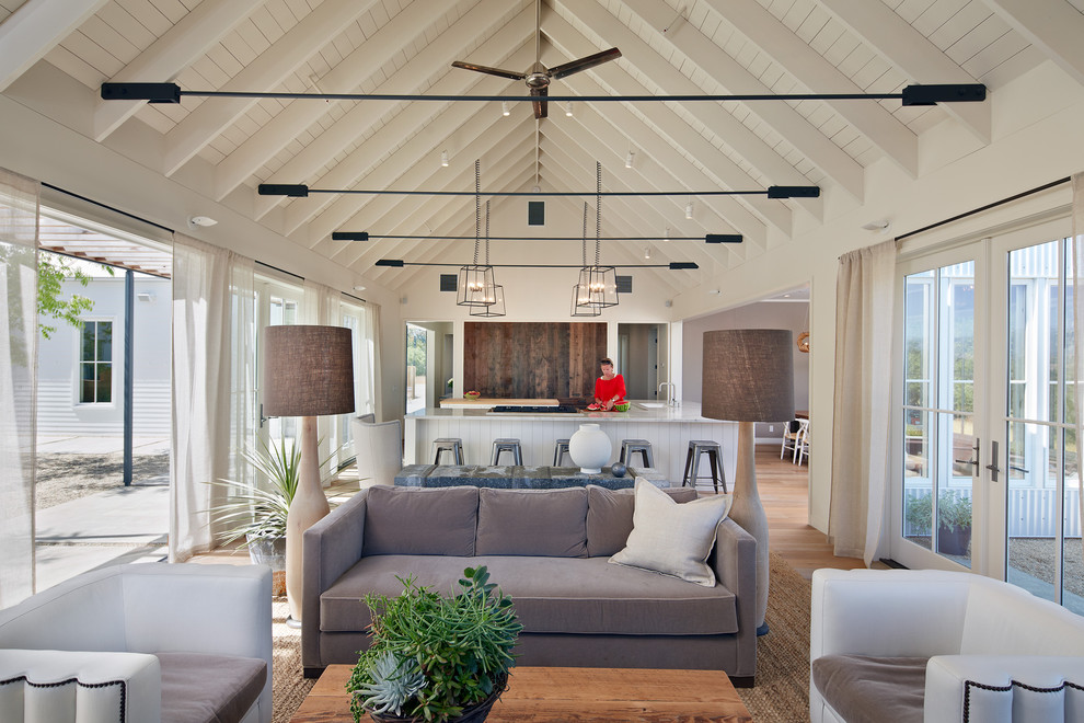 Inspiration for a country open concept living room remodel in San Francisco with white walls