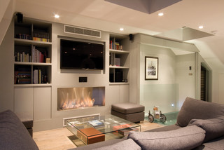 Heart of the home contemporary living room london - Como decorar un salon con chimenea ...