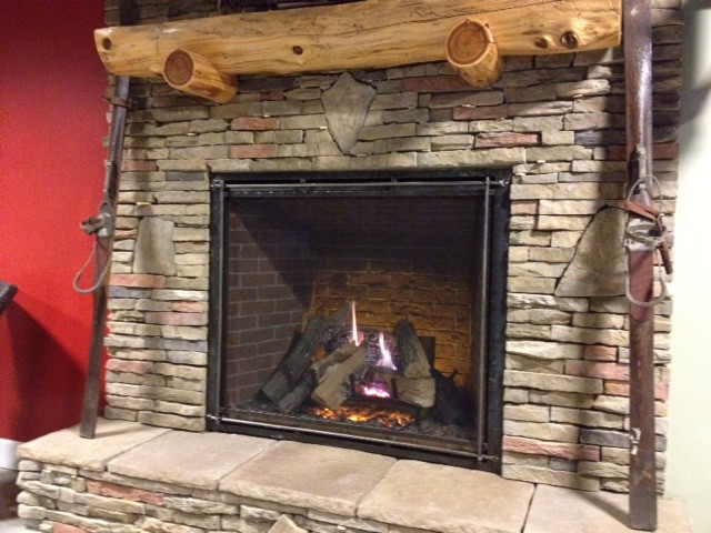 This is the new Heat-N-Glo True-42 direct vent gas fireplace with stacked stone and a ceder fireplace mantel.