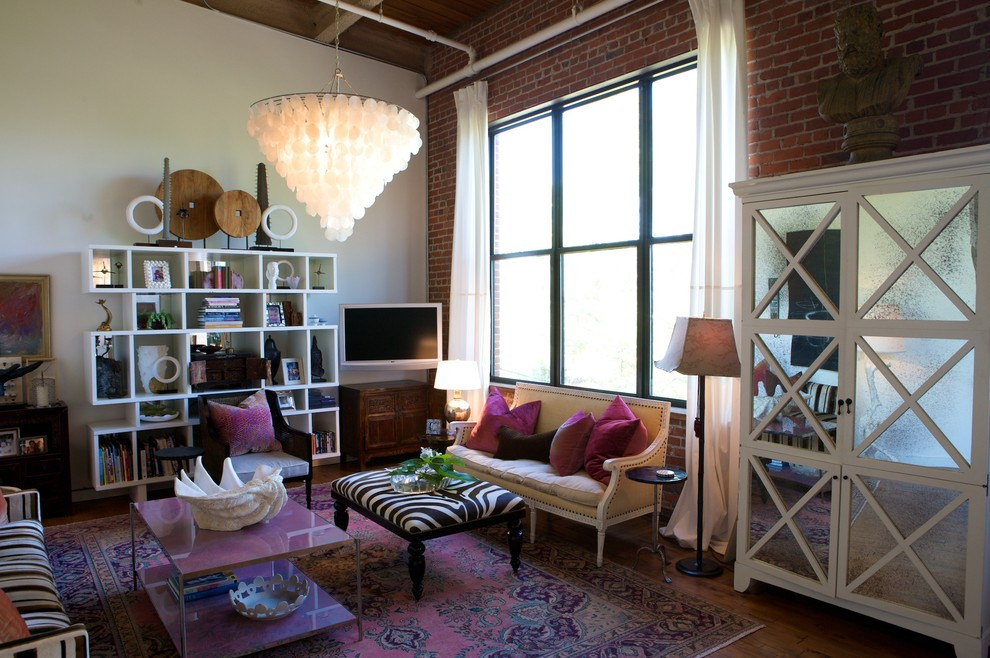 Trendy living room library photo in Raleigh with a wall-mounted tv