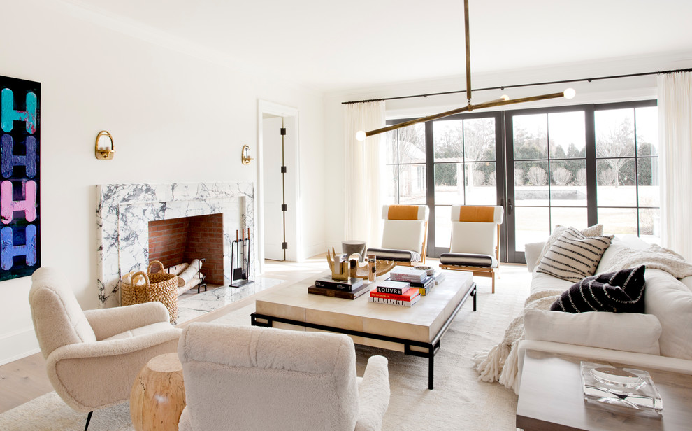 Large danish formal and enclosed light wood floor and beige floor living room photo in New York with white walls, a standard fireplace, a stone fireplace and no tv