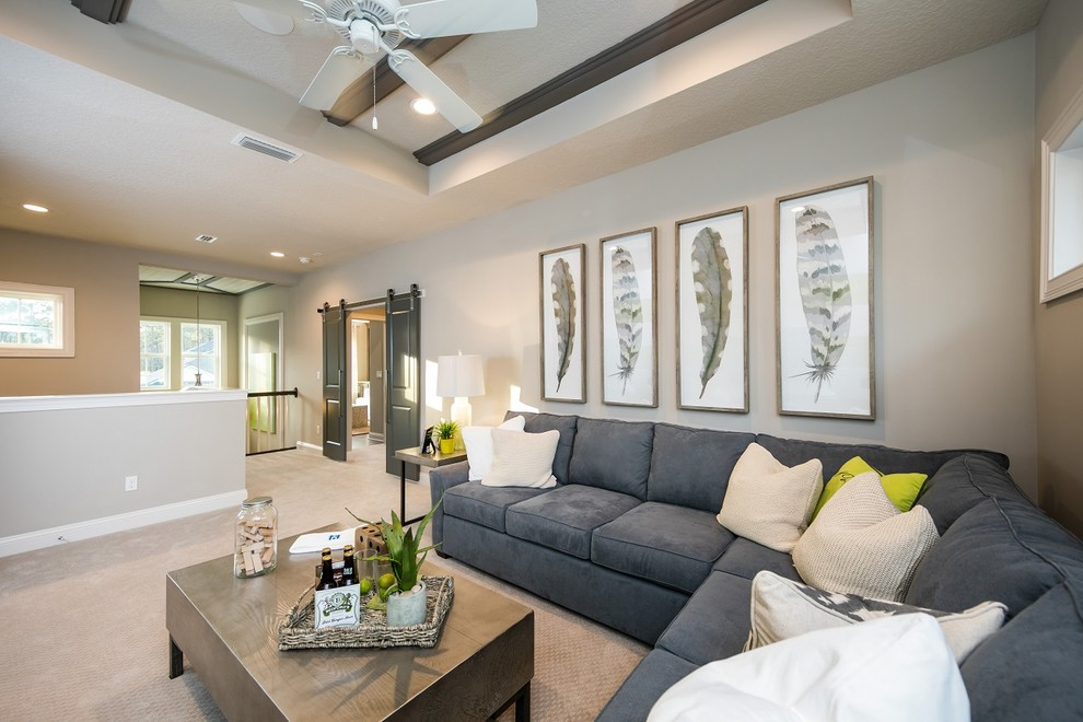 Inspiration for a transitional loft-style carpeted living room remodel in Jacksonville with brown walls