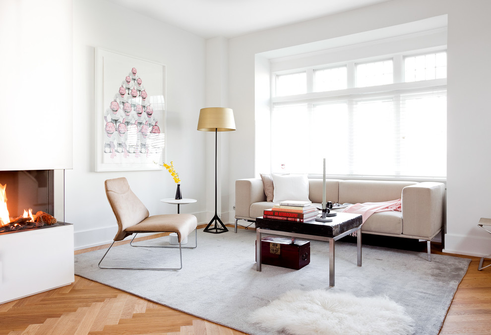 Inspiration for a mid-sized transitional open concept and formal light wood floor living room remodel in Vancouver with white walls, a corner fireplace, a plaster fireplace and no tv